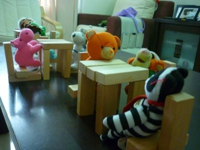 Restaurant setup with soft toys and blocks
