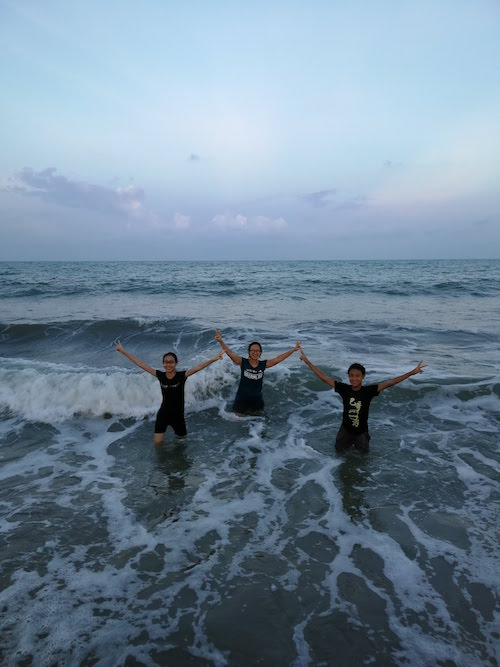 Swimming at Cherating beach