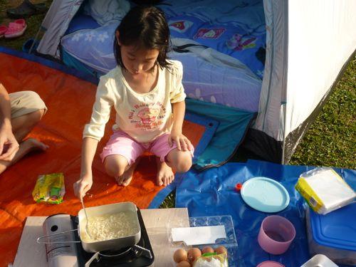 Preparing Breakfast next to Tents